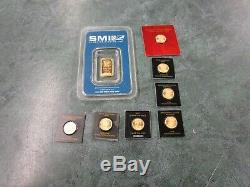 8 total -7 x 1 gram gold Maple leafs and 1 x 1 gram Sunshine mint gold coins/Bar