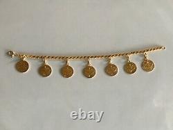 Gold Coin bracelet 8 length 7 24k goldcoins with 22 k chain 20.4 grams